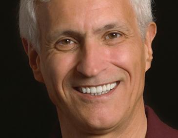 Smiling instant orthodontics patient of Dr. John Schmid