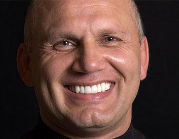 Smiling male patient of Dr. John Schmid