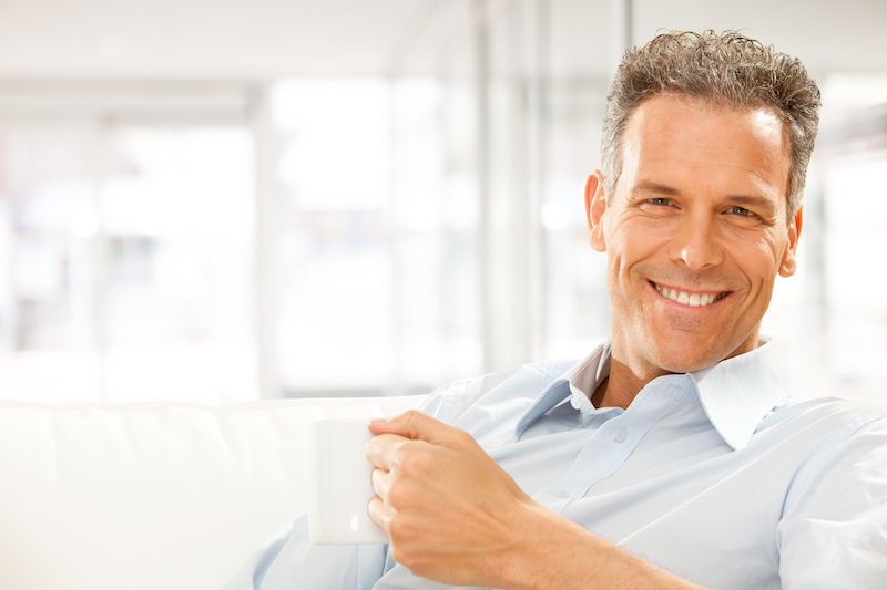 Smiling middle aged man showing off his attractive smile after having a dental implant placed