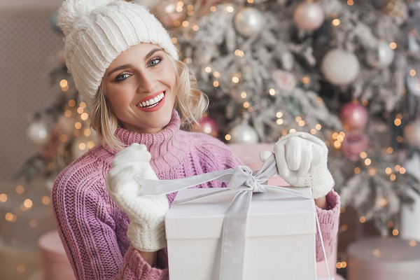 woman smiling with Christmas gift